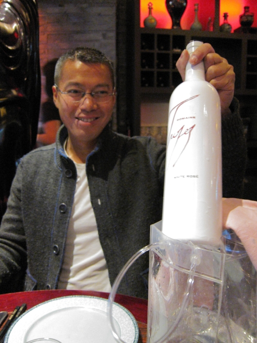 Jacques with a delicious bottle of White Rosé at Chez Tsou in the Marais.