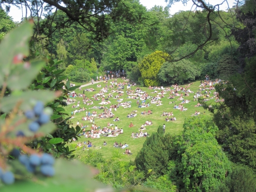 Sunbathers on the field below Rosa Bonheur in the Parc des Buttes-Chaumont on a sunny Sunday.