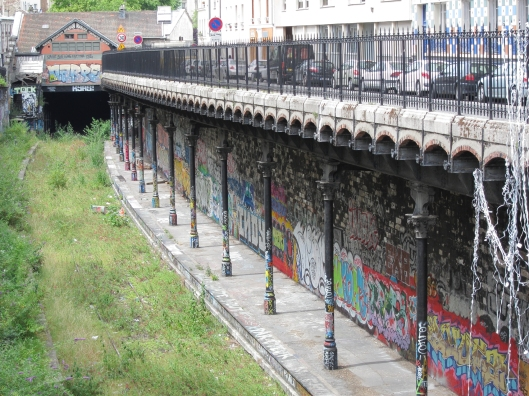 Street art at an abandoned railway station (gare de Ave. Saint-Ouen) on the Petite Ceinture in Paris.