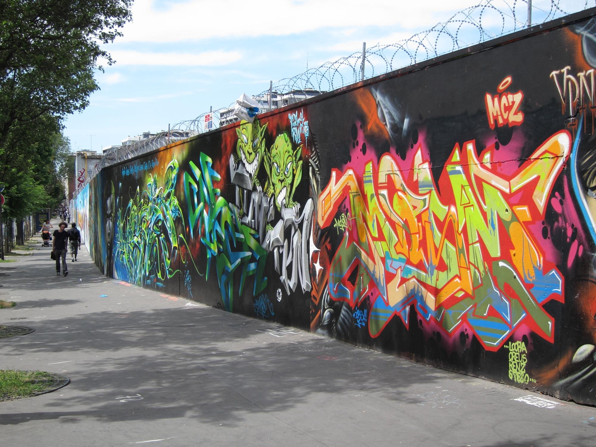 Street art on a wall along the rue Ordener in Paris.