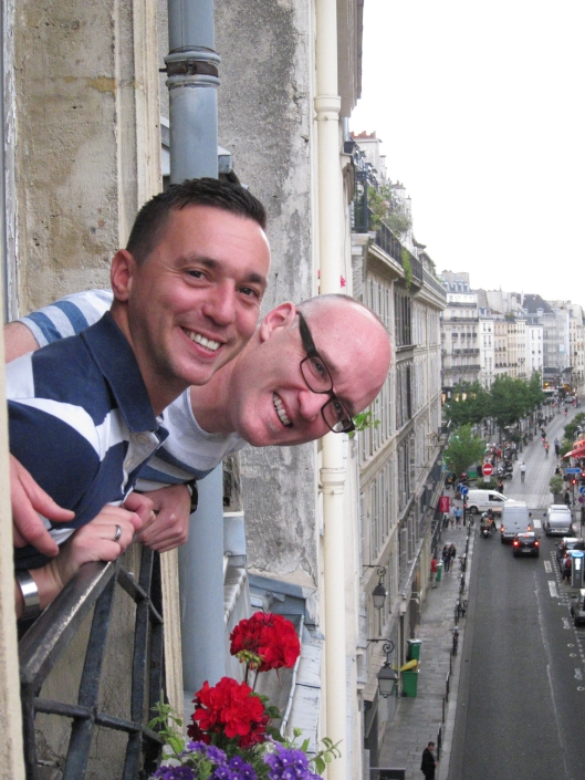 Sylvain and Jaime at the window of my 2014 apartment in Saint-Paul.