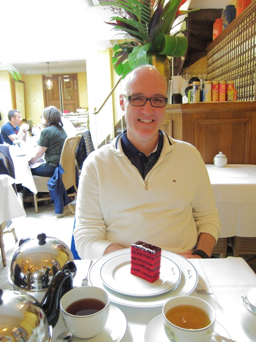 Jaime preparing to enjoy his dessert at Mariage Frères in the Marais.