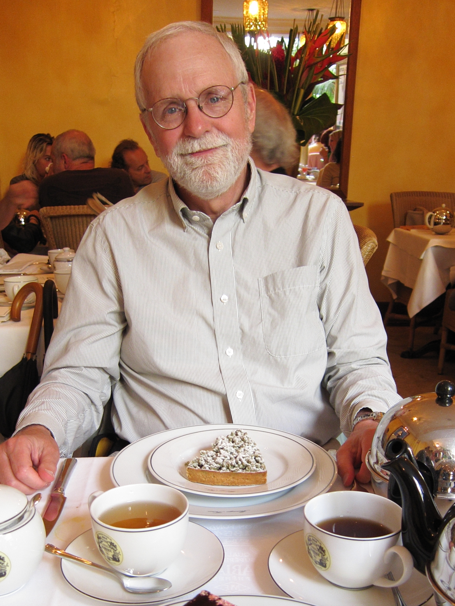 Bob in seventh heaven with his cherry tart dessert at Mariage Frères in the Marais.