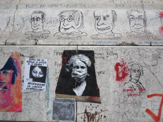 Graffiti since the Charlie Hebdo murders in January, 2015, on the base of the statue of Marianne in the Place de la Republique. (Photo May, 2015)