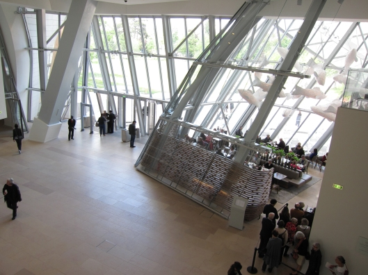 "View of the lobby at Fondation Louis Vuitton, with the pricey "" Le Frank "" restaurant at right."