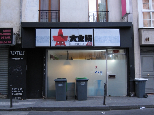 The modest store front of Fondue 59.