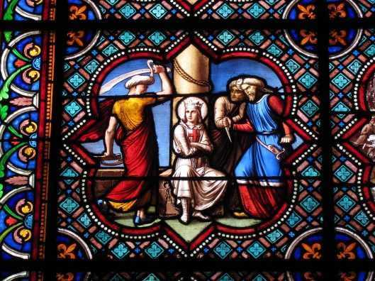 The stained glass windows are lovely but fairly recent. This one, for example, depicts Marine Le Pen beset by Arabs, but protected by her faith.
