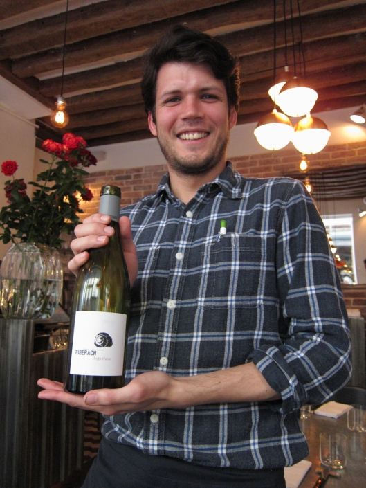 One of our waiters at Frenchie with our first wine.