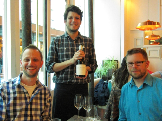 Our first waiter with our third wine, flanked by Matt and Chris.