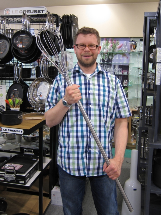 Chris with an enormous whisk in an industrial cookware shop on rue Montmartre.