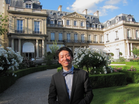 Zhizhong in the private garden of the U.S. Ambassador's residence.
