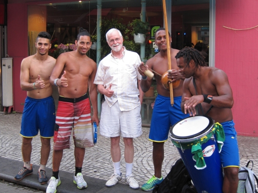 Bob bonding with Brazilian street acrobats on rue Montorgueil.