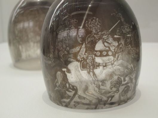 Battle scene etched in soot on the inside of a wine glass, by Patrick Neu at Palais de Tokyo.