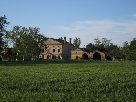 In addition to the main house there are farm buildings on each side.