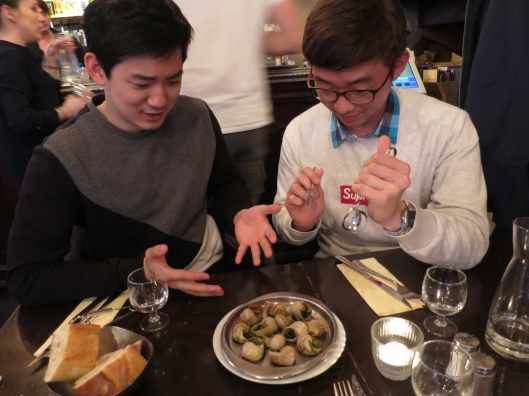 My Korean friends contemplate their first escargots with a mix of anticipation and apprehension.