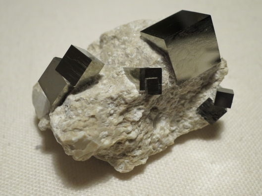 Rock with cubical crystals of fools gold.