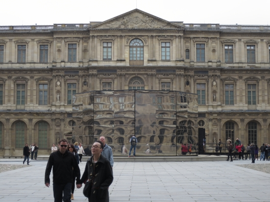 Panorama by Eva Jospin at the Louvre. Mirrors outside reflect the buildings of the courtyard.