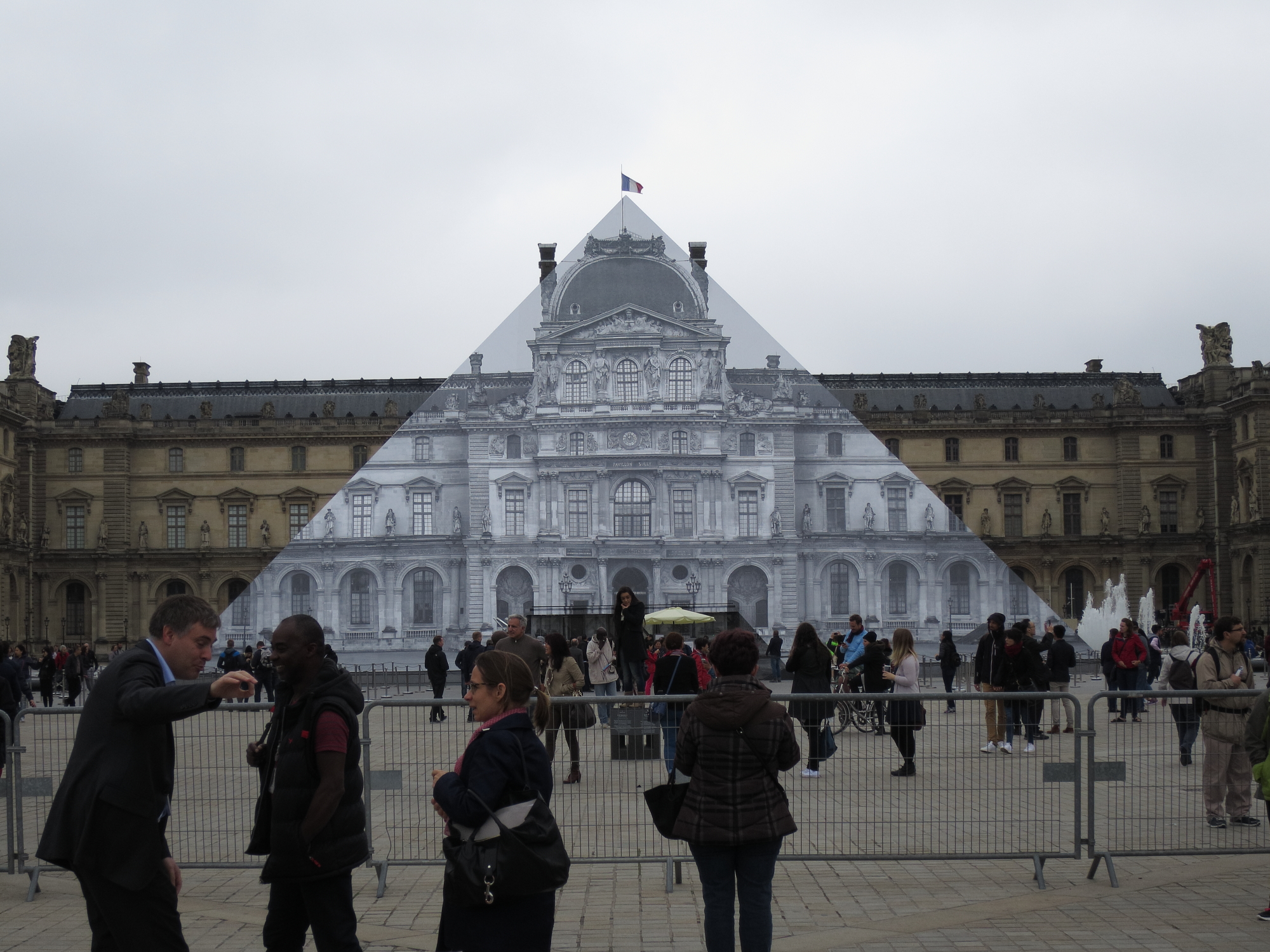 Street artist JR makes the pyramid disappear -- from one perspective