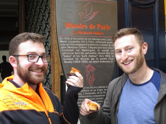 Jared W and friend with their first puits d'amour (wells of love) from Stohrer's