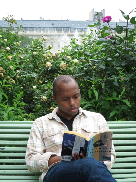 Sherard pretending to read Foucault in the garden of the Palais Royal
