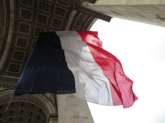 Tricolor flying beneath the Arc de Triomphe