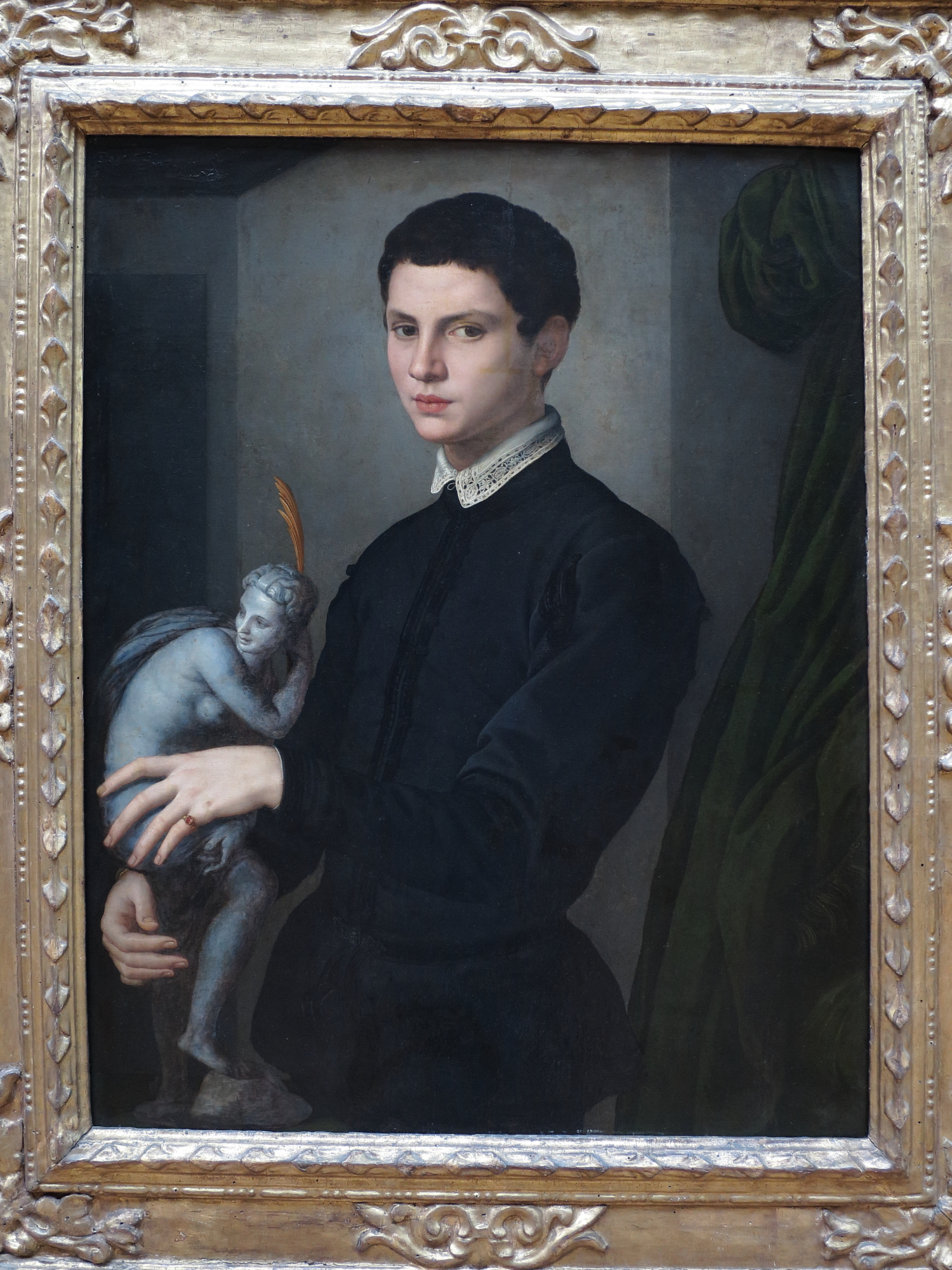 Portrait of a Man Holding a Statuette by Bronzino, Florence, 1503 - id. 1572